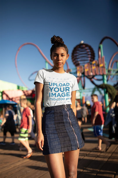 Mockup of a Girl Wearing a T-Shirt at an Amusement Park 18321