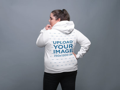 Back Shot Pullover Hoodie Mockup Featuring a White Woman with a Ponytail 21025