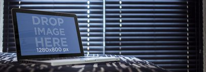 Macbook Pro Mockup Template at a Bedroom With Window Blinds
