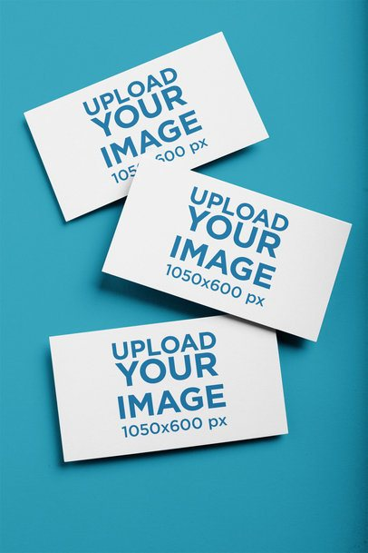Mockup of Three Business Cards on a Solid Color Surface 21900