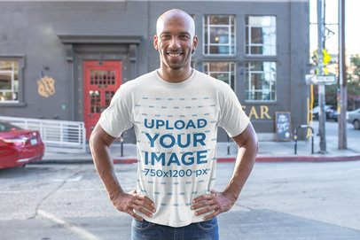 T-Shirt Mockup of a Man Standing Confidently in an Urban Setting 18235