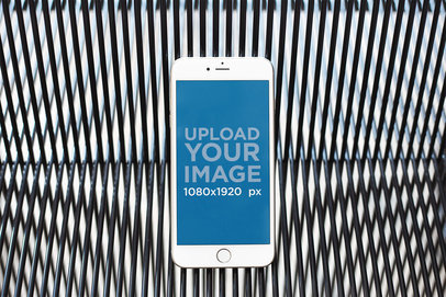 iPhone Mockup Floating Against a Patterned Black Vinyl Cord Background 21626