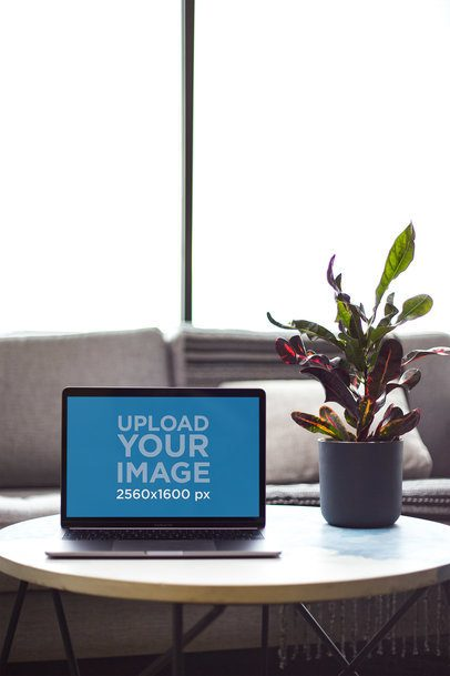 MacBook Mockup on a Coffee Table Next to a Plant Pot 21615