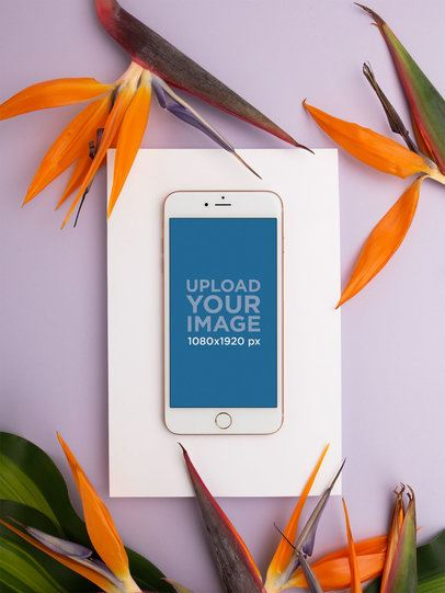 iPhone Mockup Lying Near Birds of Paradise Flowers 21749