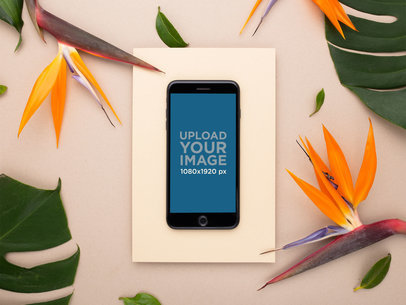 Space Gray iPhone 8 Plus Mockup with Birds of Paradise Flowers 21750