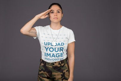 Round Neck Tee Mockup Featuring a Veteran Woman Saluting Against a Gray Background 21229