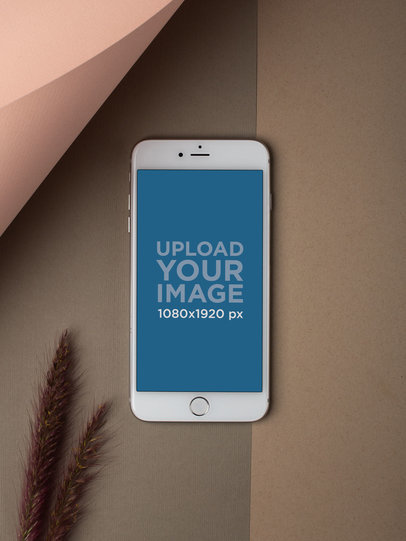 iPhone Mockup Lying Next to a Rye Plant a21752