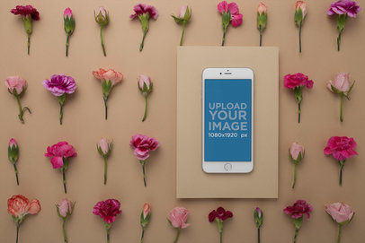 Silver iPhone Mockup on a Rectangular Cardboard Over a Surface with Flowers 21757
