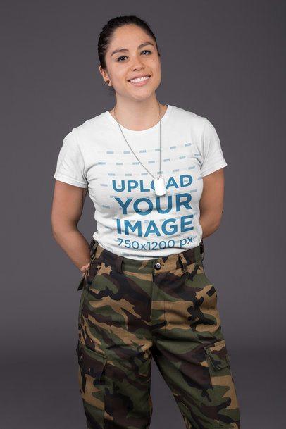 T-Shirt Mockup of a Female Veteran Against a Gray Wall 21231