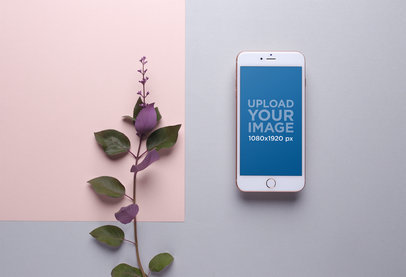 Mockup of a Gold iPhone 8 Plus over a Grey and Pink Background next to a Purple Flower 21823