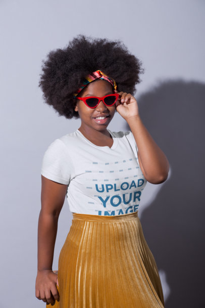 T-Shirt Mockup Featuring a Woman Wearing a Gold Pleated Skirt 21707