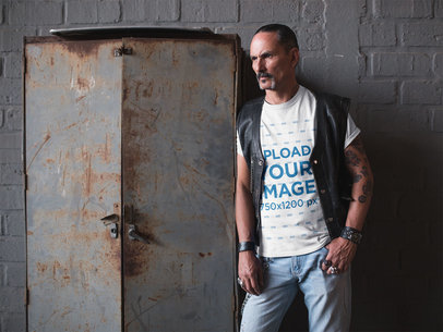 T-Shirt Mockup of a Biker Leaning on a Rusty Storage Cabinet 20251