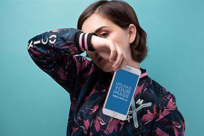 Gold iPhone Mockup of a Woman Covering her Face Against a Cyan Background 21845