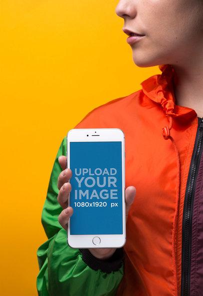 Silver iPhone 8 Mockup Featuring a Woman Wearing a Windbreaker Jacket 21849