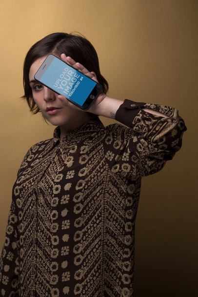 Space Grey iPhone Mockup Held by a Woman Wearing a Brown Dress Shirt 21851