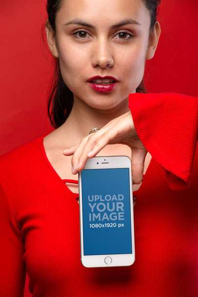 Mockup of a Woman Holding a Silver iPhone 8 Wearing All Red 21966