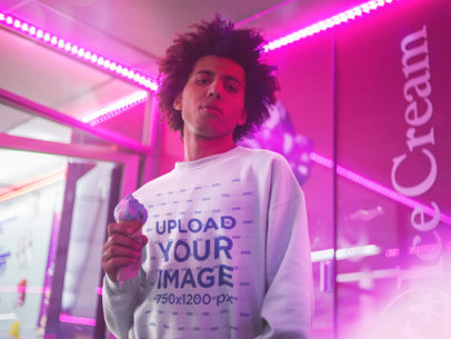 Crewneck Sweater Mockup of a Man with an Afro Hairstyle Holding an Ice-Cream Under Pink Lights 18337
