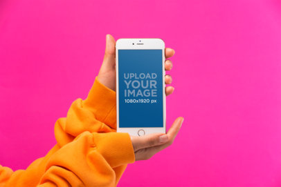 iPhone 8 Plus Mockup In Front of a Hot Pink Background 21969