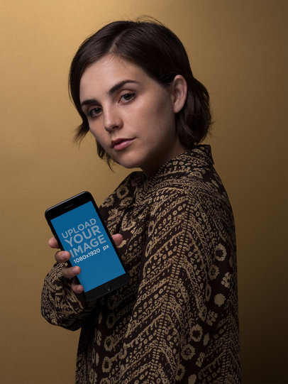 Space Grey iPhone 8 Plus Mockup Held by a Woman in Front of a Brown Background 21852