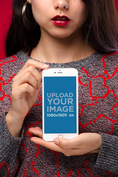 Mockup of a Girl with a Crewneck Embroidered Sweater and a Nose Piercing Holding a Silver iPhone 8 Plus 21960