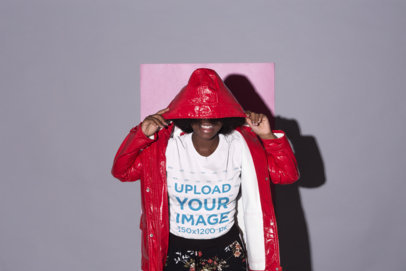 Mockup of a Woman Wearing a T-Shirt Covering Her Face With Her Hood 21712