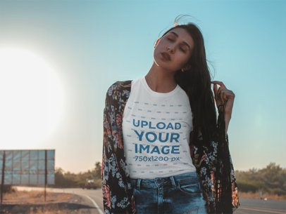 Tshirt Mockup Featuring a Girl with an Indie Outfit Posing by a Desert Road 18887