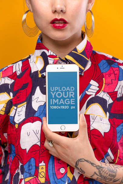 Mockup of a Gold iPhone 8 Held by a Woman Wearing a Colorful Patterned Shirt  21962