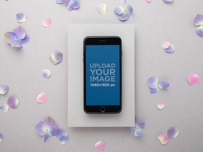 Mockup of a Space Grey iPhone Surrounded by Hydrangeas 21979