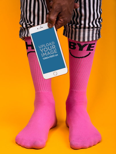 iPhone 8 Mockup Held by Someone Wearing Hot Pink Socks 22086