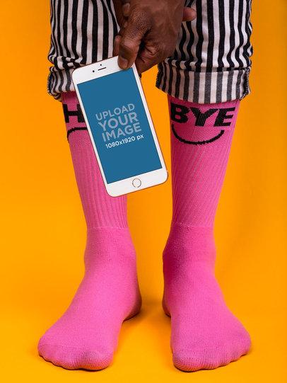 iPhone 8 Mockup Held by Someone Wearing Hot Pink Socks 22086