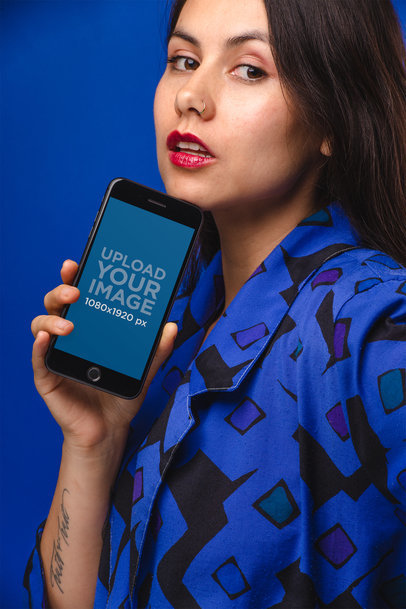 iPhone 8 Plus Mockup Featuring a Woman Wearing Blue 21974