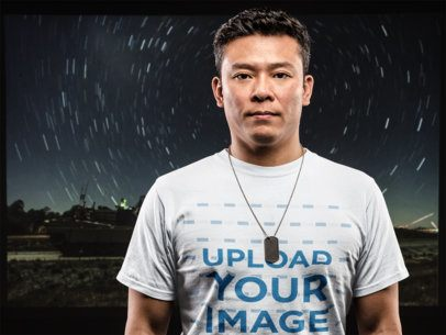 T-Shirt Mockup of an Army Veteran in Front of a Starry Night Background 21247
