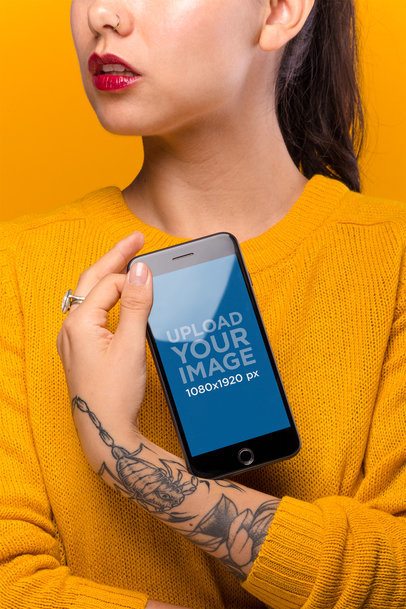 iPhone 8 Plus Mockup Featuring a Woman with Tattoos 21964