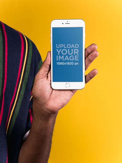 Mockup of a Silver iPhone 8 Plus Held by a Man Wearing a Striped Shirt 22128