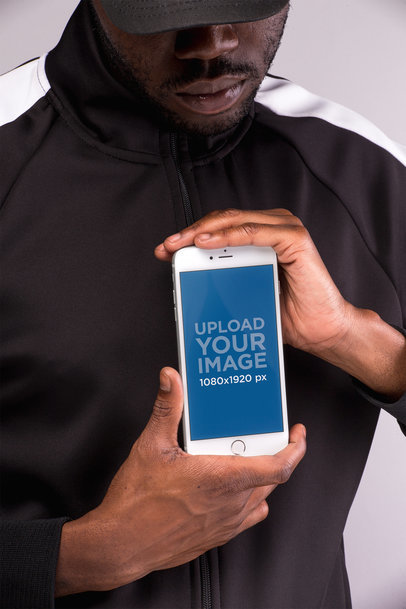 iPhone 8 Plus Mockup Held by a Man With Both Hands 22132