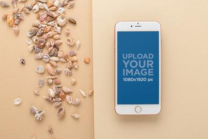 Gold iPhone 8 Plus Mockup Next to Seashells 22142