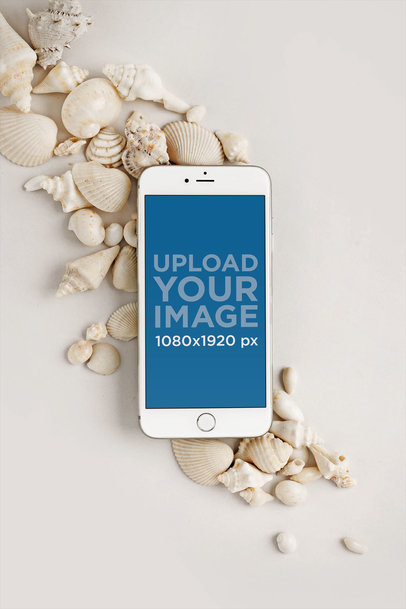 Mockup of an iPhone Lying Over Small Seashells 22141