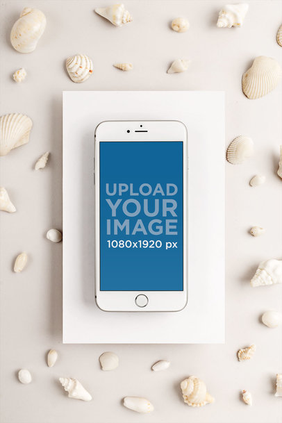 Silver iPhone 8 Plus Mockup on a Cardboard Surrounded by Seashells 22139