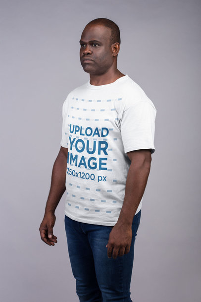 T-Shirt Mockup of a Serious Man With His Arms by His Side 21482