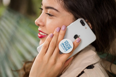 PopSocket Mockup Held by a Woman Talking on the Phone 22074