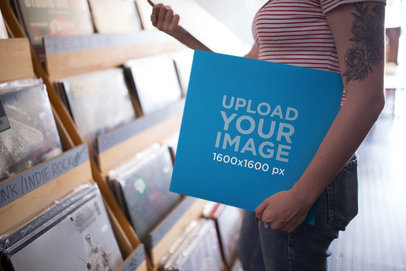 Mockup Featuring a Girl Holding a Vinyl Album Cover at a Vinyl Record Shop 22093