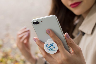 Mockup of a PopSocket Held by a Woman 22076