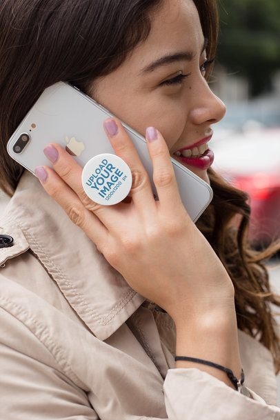 Phone Grip Mockup Held by a Smiling Woman 22077
