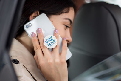 PopSocket Mockup Featuring a Girl Calling with an iPhone 8 Inside a Car  22079