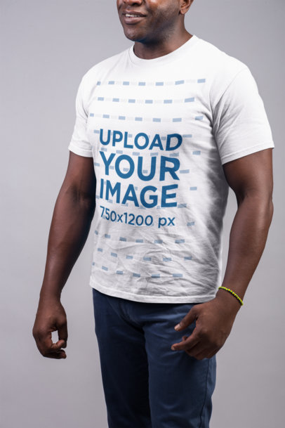 Mockup of a Smiling Man Wearing a T Shirt and Blue Trousers 21488