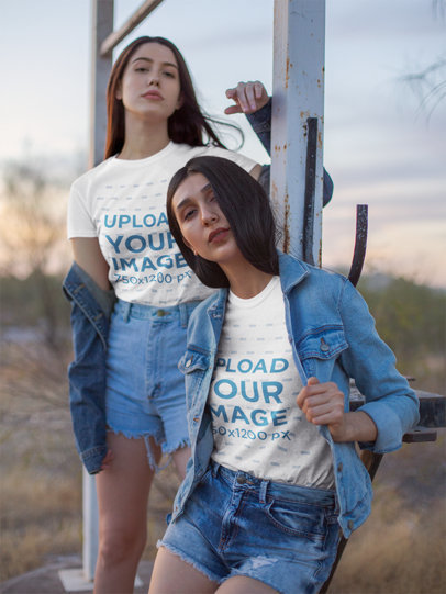 Mockup Featuring Two Young Female Models Posing with a T-Shirt and Denim Outfit 18871