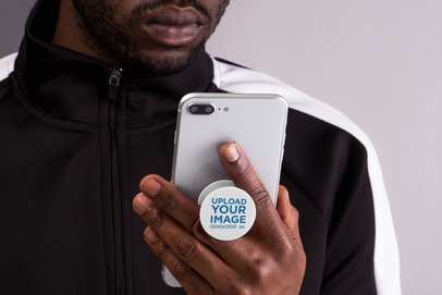 PopSocket Mockup Featuring a Man Looking at His Smartphone 22156