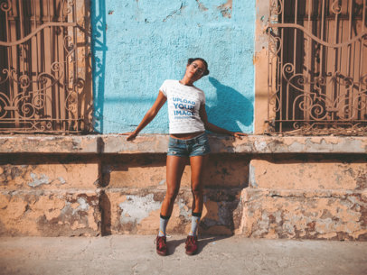T-Shirt Mockup of a Woman in Front of an Old Building 19370