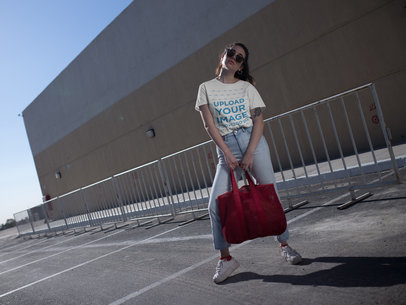 Crewneck Tee Mockup Featuring a Girl Posing in a Parking Lot 20038