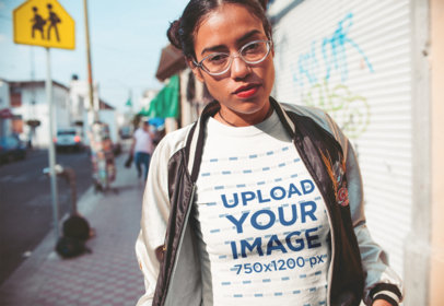 T-Shirt Mockup Featuring a Woman Wearing Clear Glasses 19373